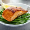 Grilled,blackened,salmon,served,with,green,beans,and,lemon